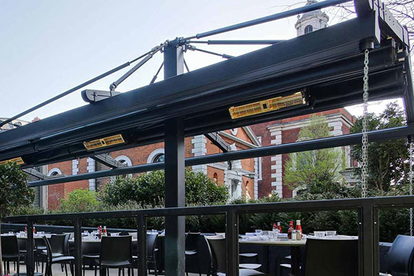 Bar terrace with outdoor infrared heaters installed
